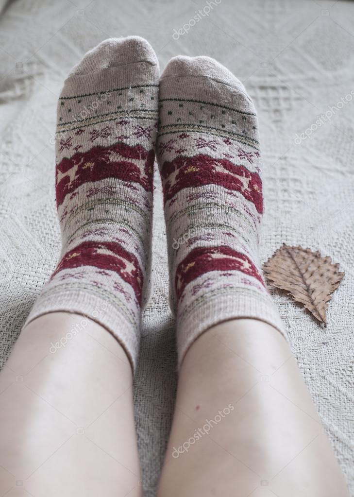 Knitted woolen socks and oak leaf
