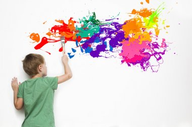 Child drawing an abstract picture