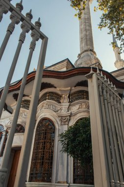 Low angle view of ornament on facade of Mihrimah Sultan Mosque near fence on blurred foreground, Istanbul, Turkey stock vector