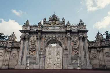 Entrance of Dolmabahce palace with sky at background, Istanbul, Turkey stock vector