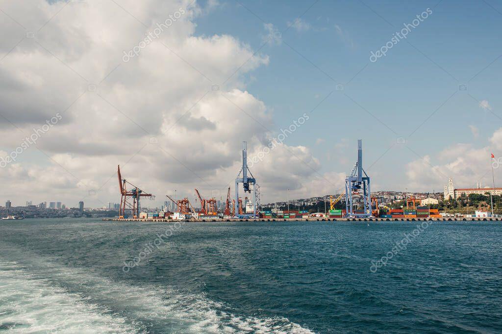 High cranes of cargo port on coast of sea in Istanbul, Turkey stock vector