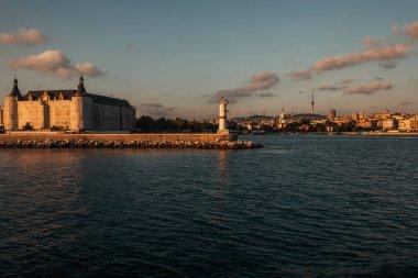 Lighthouse on coast of sea during sunset, Istanbul, Turkey stock vector