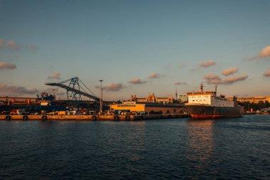 Cargo ship moored near port during sunset, Istanbul, Turkey stock vector