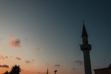 Low angle view of column of Mihrimah Sultan Mosque and sky during sunset at background, Istanbul, Turkey stock vector