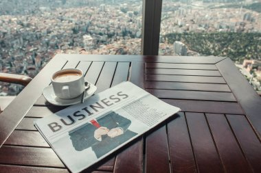 Business newspaper and coffee cup in cafe near window with aerial view of Istanbul stock vector