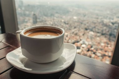 Close up view of coffee cup in cafe with aerial view of Istanbul, Turkey stock vector