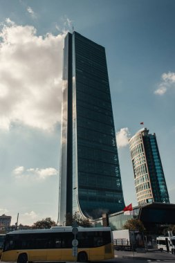ISTANBUL, TURKEY - NOVEMBER 12, 2020: bus on street near high, modern buildings stock vector