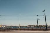bridge over Bosphorus strait against blue sky