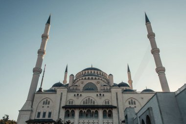 Low angle view of Mihrimah Sultan Mosque against cloudless sky in Istanbul, Turkey stock vector