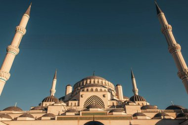 Low angle view of Mihrimah Sultan Mosque against blue, cloudless sky, Istanbul, Turkey stock vector