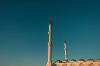 Blue, cloudless sky over high minarets of Mihrimah Sultan Mosque, Istanbul, Turkey stock vector