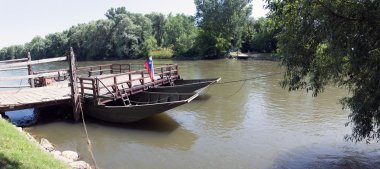 Traditional wooden ferry on Mura river in Prekmurje, Slovenia, tourist attraction