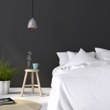 Bedroom with a wooden stool and a concrete lamp