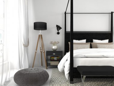 Black bed in a white room