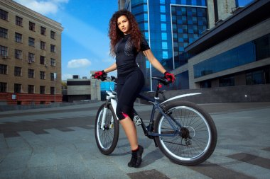 adorable sports woman on bicycle