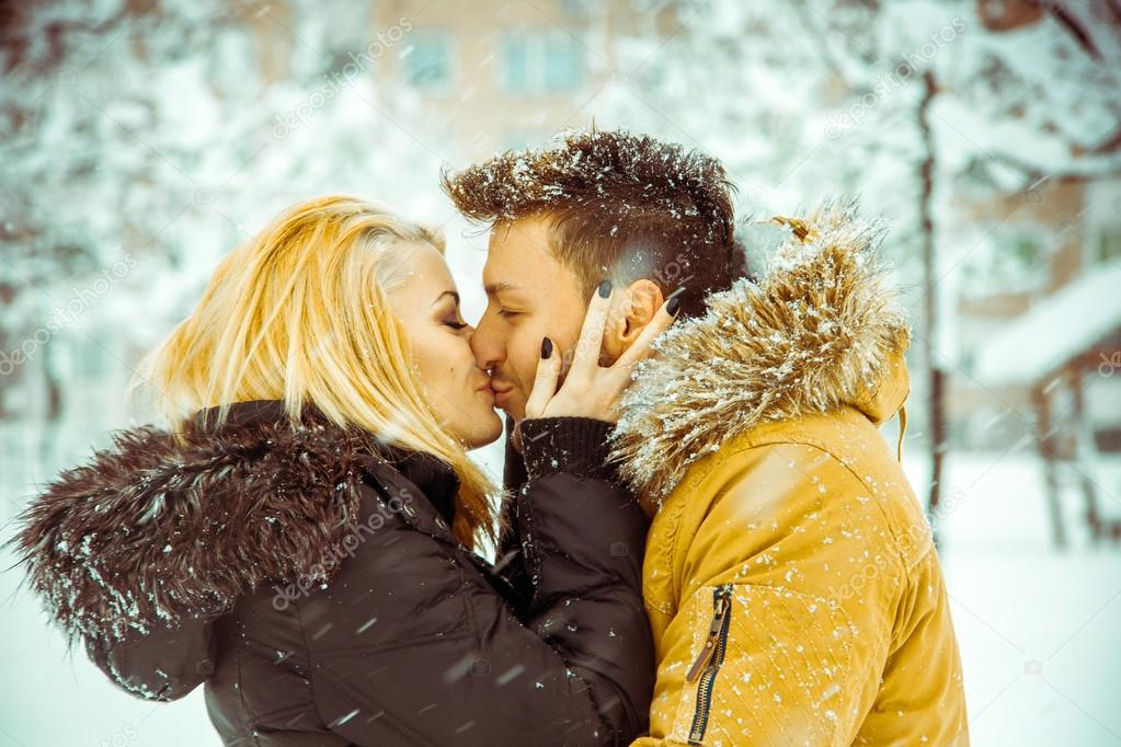 True Love Man And Woman Happily Kissing On The Street In The Sn