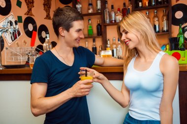 boy meets a girl and treat her cocktail in the bar