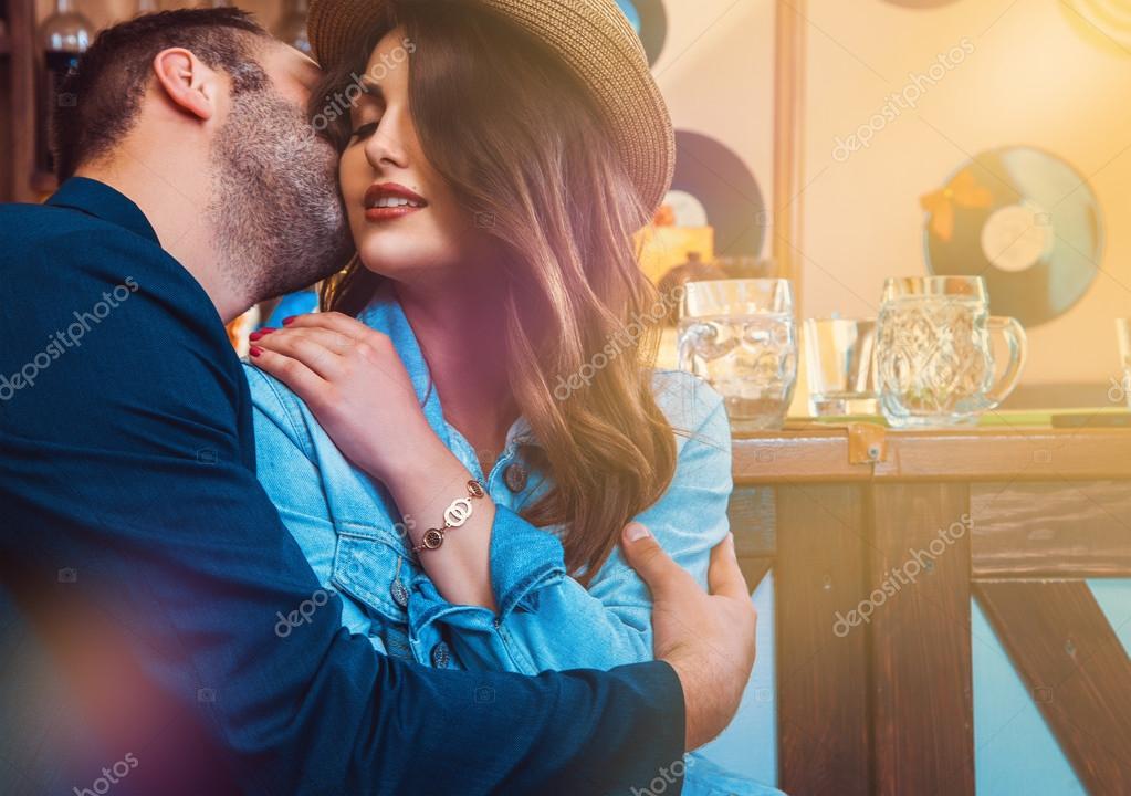 attractive lovers kissing and hugging at bar