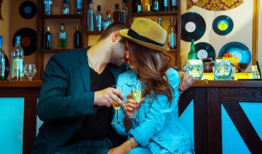 Woman seducing a man in a bar and drinking champagne. horizontal photo stock vector