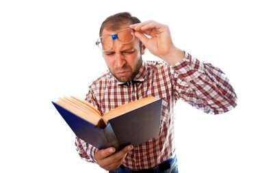 Adult man with poor eyesight try to read a book