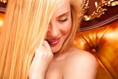 Shy young blonde smiling