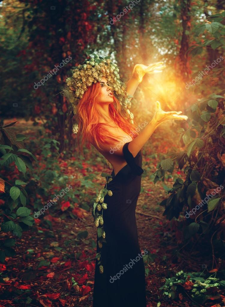 Fantasy photo of young redhair lady wizard
