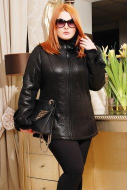 Plus size woman in winter coat