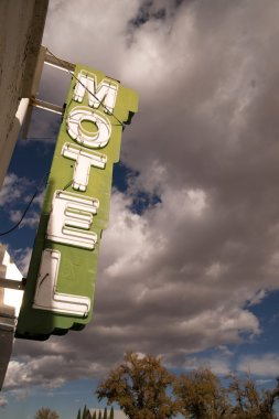 Neon Motel Sign Clear Blue Sky White Billowing Clouds