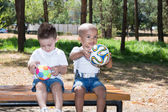 Little boys  with soccer ball in park
