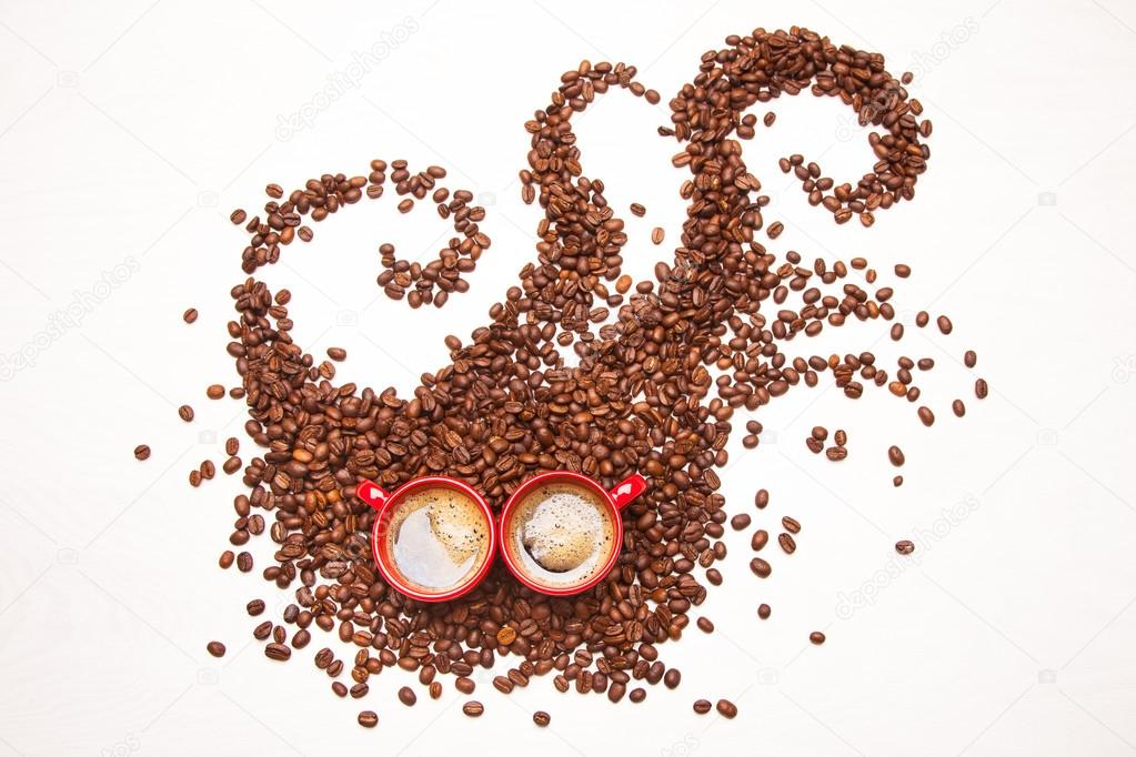 coffee monster coffee beans and 2 cups of espresso stock photo