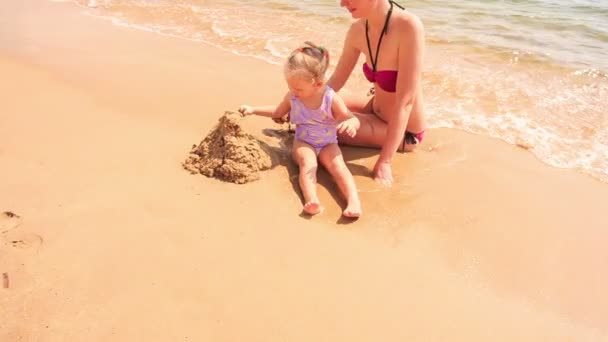 mother and daughter building castle