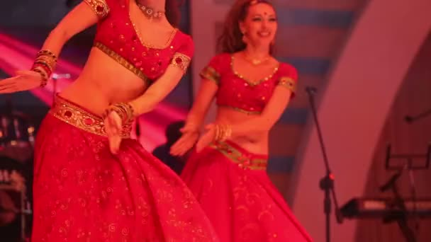 Girls dancing in national Indian suits