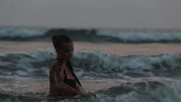 Girl Performers dance acrobatic stunts in water