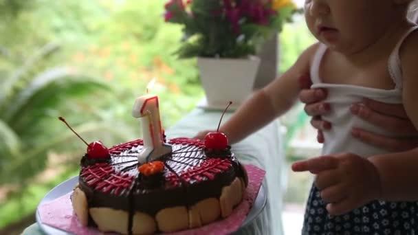 Child and birthday cake