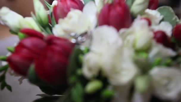 Wedding rings on roses