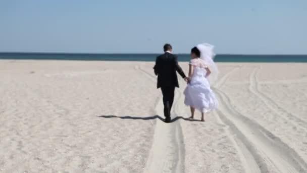 Bride with the groom on beach