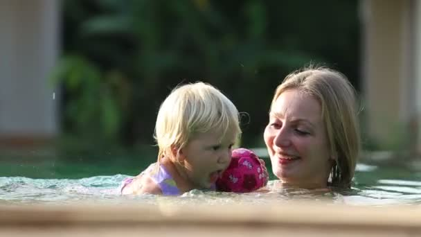 Small   child swim with mother