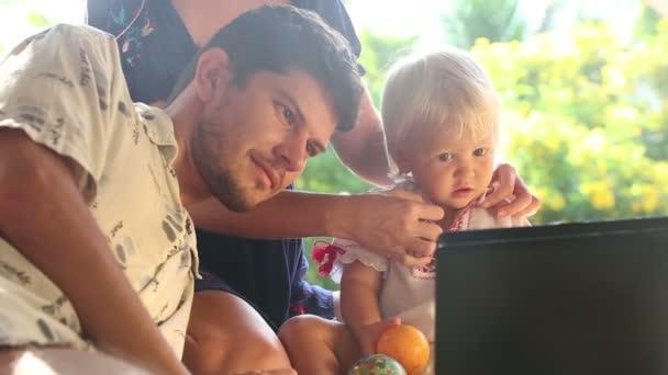 Family watching cartoon