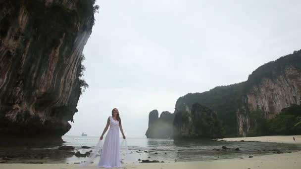 Young bride on beach