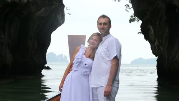 Bride and groom  on boat in sea