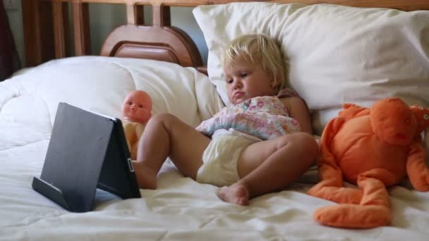 Girl with toys watching  cartoons