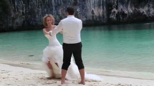 Bride and groom on tropical beach