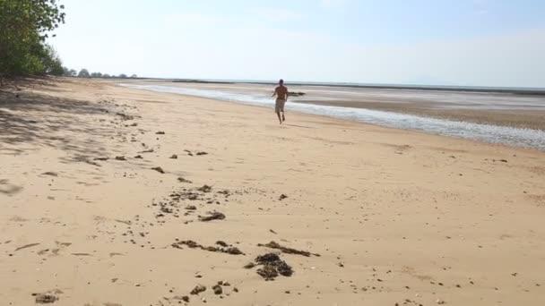 old man running on beach