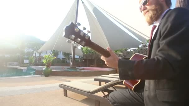 Man in black   playing guitar
