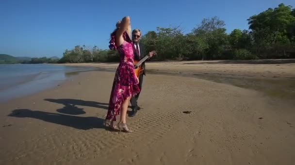 Girl and guitarist on beach