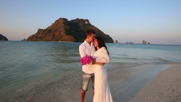 Bride and groom on sea beach