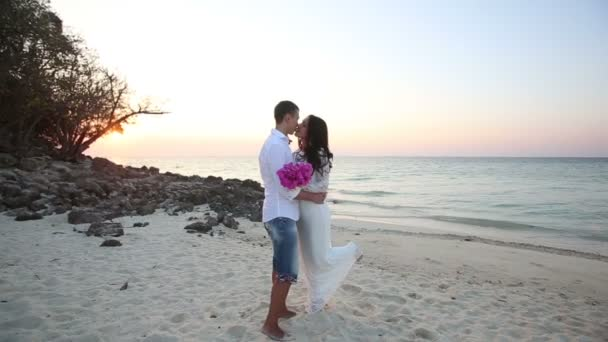 bride and handsome on sea beach