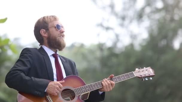 Guitarist In Black Plays Guitar And Sings Stock Footage