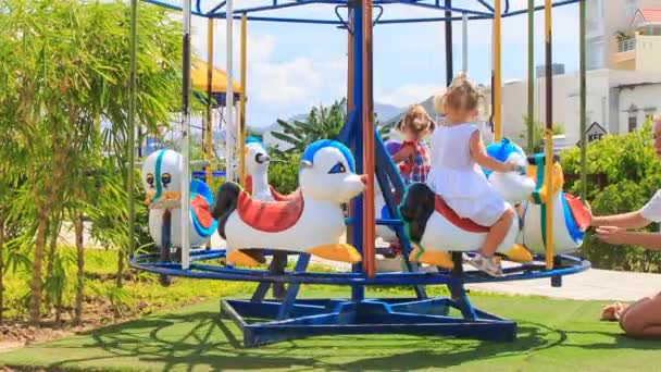 two little girls  on merry-go-round