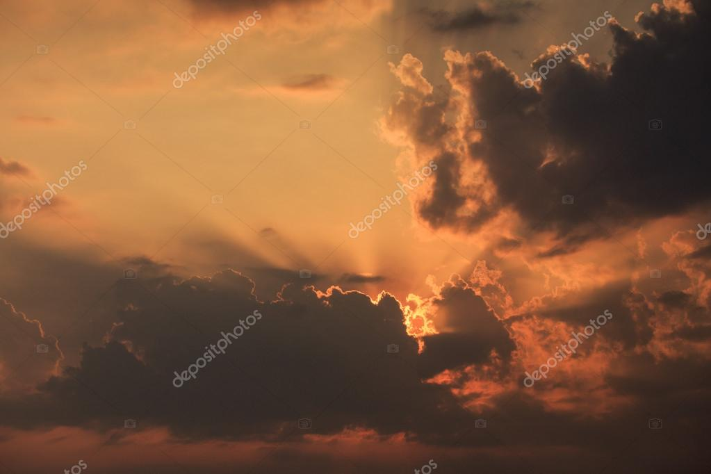 rising sunbeams from behind   clouds